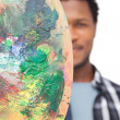 Male painter with palette — Stock Photo