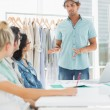 Fashion designers discussing designs — Stock Photo #42922883