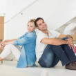 Couple with boxes in a new house — Stock Photo
