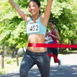 Marathon runner crossing finish line — Stock Photo #42923555