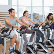 Happy people working out at spinning class — Stock Photo #42923757