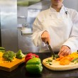 Chef cutting vegetables — Stock Photo #42923859