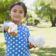 Beautiful little girl holding cotton candy at park — Stock Photo