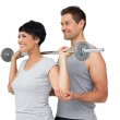 Personal trainer helping woman with weight lifting bar — Stock Photo
