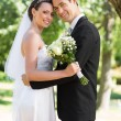 Newly wed couple with head to head — Stock Photo #42925567