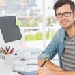 Casual male photo editor using graphics tablet — Stock Photo
