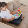 Relaxed girl reading storybook — Stock Photo #42925987