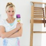Woman holding paint brush — Stock Photo #42926287