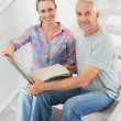Happy couple picking out carpet samples together — Stock Photo #42927449