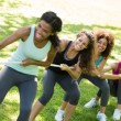 Women pulling a rope in tug of war — Stock Photo #42928633