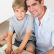 Father and son using laptop — Stock Photo #42928731