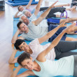 Fitness class stretching legs and hands in row — Stock Photo