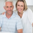 Smiling couple using laptop together at the counter — Stock Photo