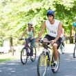 Cyclists riding bicycles on street — Stock Photo #42929439