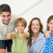 Family showing thumbs up — Stock Photo #42929549