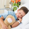 Boy with teddy bear sleeping in hospital — Stock Photo #42929945