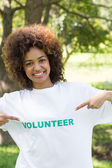 Environmentalist pointing at volunteer tshirt — Stock Photo