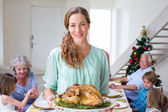 Mother with Christmas meal — Stock Photo