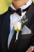 Mid section of flowers on lapel of male — Stock Photo