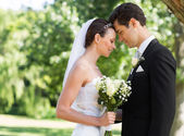 Newly wed couple with head to head — Stock Photo