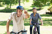 Couple enjoying bike ride in park — Stock Photo