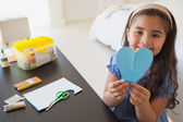 Girl holding heartshape paper — Stock Photo