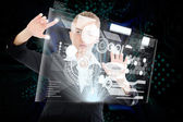 Blonde businesswoman touching interface — Stock Photo