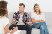 Man speaking to therapist at couples therapy — Stock Photo