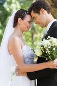Bride and groom in garden — Stock Photo