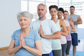 Sporty people with eyes closed and joined hands — Stock Photo