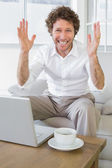 Worried well dressed man with laptop at home — Foto de Stock