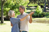 Couple dancing in countryside — Stock Photo
