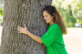 Environmentalist embracing tree trunk — Stock Photo