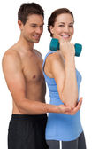 Male trainer assisting woman with dumbbell — Stock Photo