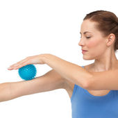 Woman holding stress ball on arm — Stock Photo