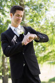 Bridegroom checking time — Stock Photo