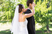Bride covering eyes of groom — Stock Photo