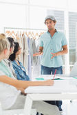 Fashion designers discussing designs — Stock Photo