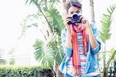 Brunette taking a photo outside — Stock Photo