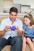 Father opening gift given by daughter — Stock Photo