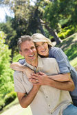Couple with arm around in park — Stock Photo