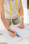 Mid section of a fashion designer working on her designs — Stock Photo
