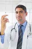 Portrait of male doctor holding an injection — Stock Photo