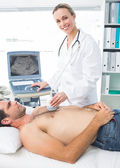 Doctor using sonogram on patient — Stock Photo