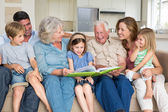Family reading storybook — Stock Photo