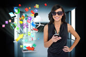 Brunette using smartphone with app icons and laptop — Stock Photo