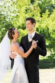 Newly wed couple dancing on wedding day — Stock Photo