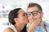 Attractive young designer getting a kiss from a co worker — Stock Photo