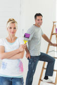 Couple with paint brush and ladder — Stock fotografie