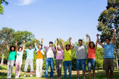 Friends with hands raised on campus — Stock Photo
